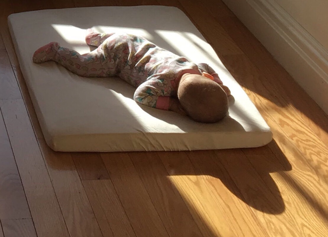 Baby On A Floor Bed Small Works